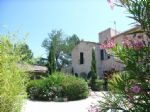 Furnished cottage among 12 other small stone residences in a landscaped park with pools.