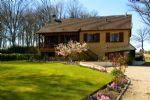 Situated in a peaceful location close to a lake and swimming pool is this light
