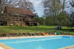 Wooden Chalet with swimming pool