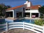 Architect villa built in 1970's offering, a 70sqm swimming pool and a wooded garden (in Canet Plage)