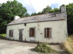 Partly restored cottage with over 7 acres of pasture and woodland