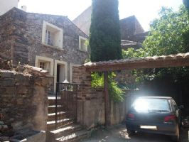 Charming stone village house with 92 m² of living space, large terrace and garden/courtyard.