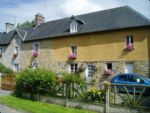 Stone house in Manche with proven business potential.