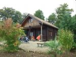 South Charente countryside. Log cabin in over 2 acres. Far-reaching views.