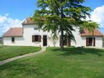 Lovely country house, on 2 hectares of land with a pond, situated in a village
