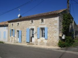 In a lovely village, renovated property with original features!