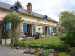 Stylish Longere set in 6300m² of pretty peaceful countryside near to the town of Isigny le buat