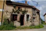 A very old stone house, with about 1 000 m2 attached land. To restore.