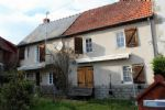 Close to Bonnat, a semi-detached house in good condition, with a small garden.