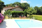 Lovely renovated house with below-ground pool and lake.