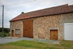Barn with land in a small and lively market town. Conversion has begun. To finish.