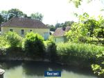 Waterside house with outbuildings in Perche national park