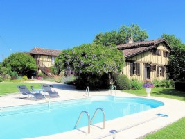.Charming cottage set in an idyllic garden with gite and pool.
