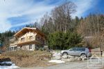 A newly built family house and 2 mazots, set in a sunny position facing the Mont Blanc massif.