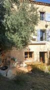 Pretty stone village house with 80 m² of living space, garden and just 10 minutes from Pézenas.