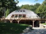 An exceptional rotating wooden house set in over 4 acres of forets.