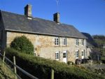 Stone house with outbuildings and almost 6 acres of land, close to village.