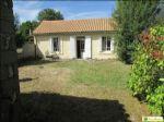 Cottage aux alentours d'Aigre avec charmant jardin clos de 300m² environ