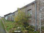 Central village cottage to renovate with small garden close to moncontour