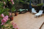 Stone house with large private sun terrace (46m2) in pretty village.