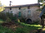 Wonderful old stone house with a large detached barn and cottage.
