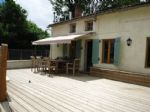 Detached, renovated cottage with large split level lounge, covered parking and 550m² garden