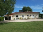 Detached bungalow with almost 2 acres and stables