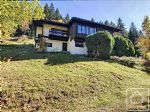 A spacious 5 bedroom chalet, uniquely designed in the distinctive 1960/70s architectural style.