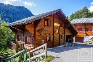 A modern chalet with separate apartment, in a sunny location with views over open fields.