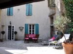 Renovated stone village house with 226 m² of living space, terrace, courtyard and pool.