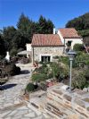 Property on 14,5 hectares with main house and 2 gites, each with their own pool and terrace.