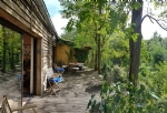 Country wooden house with 120 m living space plus 130 m² to convert on about 4500 m² of land.