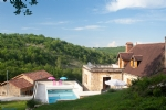 Beautiful stone property of the XVIIIth century with house, 2 gites and 3 cottages on 10 hectares.
