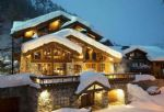 Spectacular 5 bedroom ski in and out half chalet directly on the piste (A)