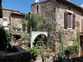 Charming stone village home with about 130 m² living space, 2 larges terraces and cellars.