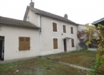 Character house with garages in small village with amenities.