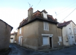 Big house with gite, garages and large garden in mediaeval quarter.
