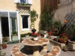 Central Castelnaudary. Renovated town house with courtyard garden. Garage.