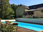Character house with 5 bedrooms and a swimming-pool.