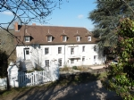 Beautiful, spacious house with outbuildings about 2ha of land with pond.