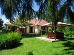 Carp lake of just under 2 acres with 3 bedroom house, gardens and paddocks, in total 8.2 acres