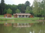 Carp lake of 2.5 acres with modern 1 bed bungalow, 1 bedroom gîte and 8 acres