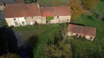 Detached property with 2 houses, sheepfold, outbuildings, land.