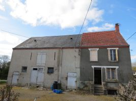 Old farm house with outbuildings, in small hamlet with lots of potential.