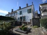 Spacious village house with income potential