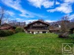 A spacious and modern chalet set in a generous sunny garden with far reaching views.