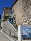 Stone village house with 92 m² of living space, 3 bedrooms, garage and terrace.