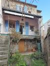 Charming renovated village house with 2 bedrooms, terrace with views, cellar and yard.