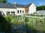 Confortable maison avec piscine naturelle