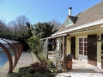 Property close Thoiry with swimming pool and landscaped garden.